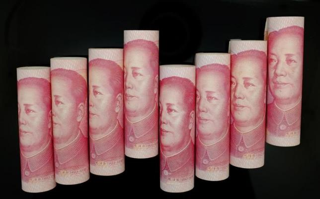 China central bank devalues the yuan after poor economic data