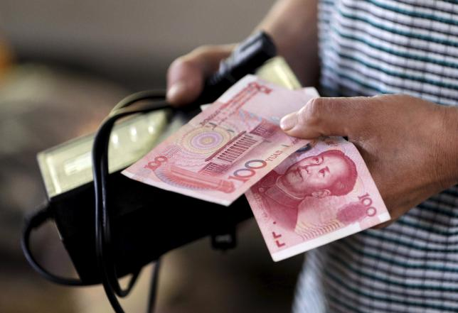 China pushes yuan down further amid fears of currency war