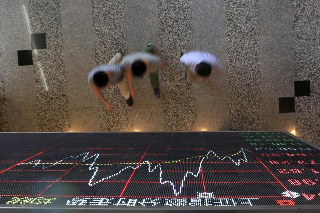 Asia stocks, euro slide as economic, political uncertainty hits
