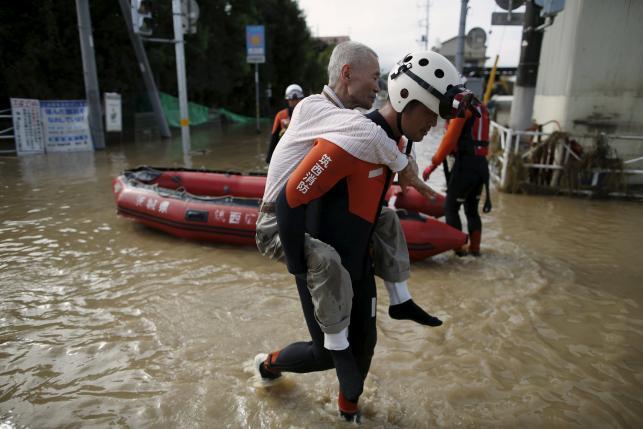 More Japan rivers burst banks triggering further floods, 23 missing