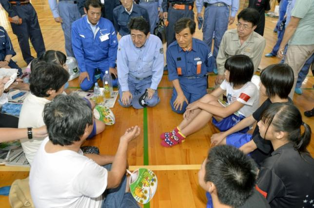 Japan resumes search for 16 missing as flood evacuees wait to return home