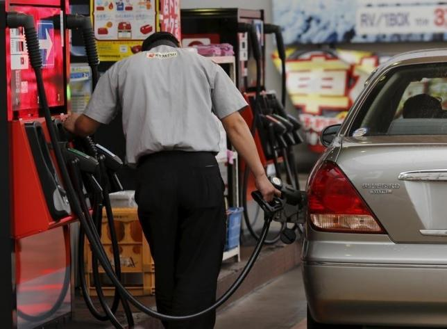 Oil prices edge up on reports of falling inventories, but glut remains in place