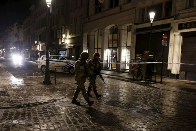 Belgian police mount raids in Brussels and other towns