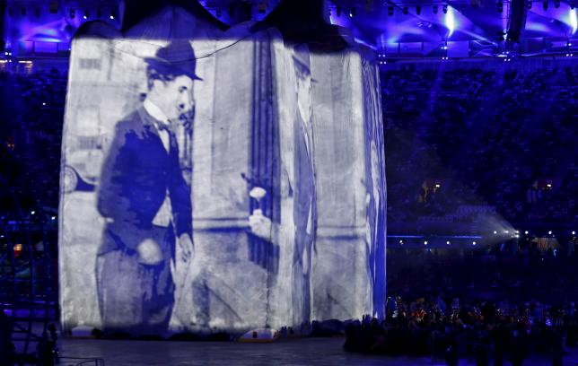 Charlie Chaplin, who spun his Tramp costume into gold, feted in archive book