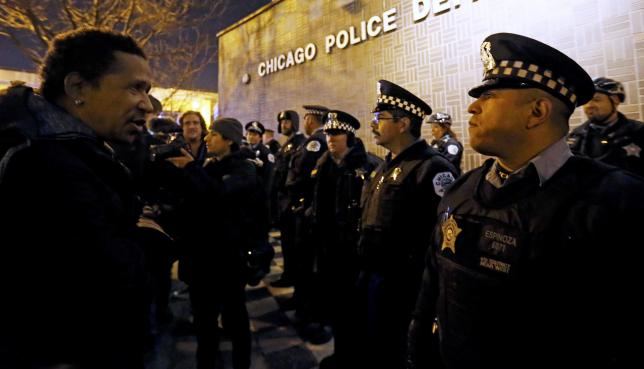 Chicago charges officer in black teen's death, releases video of shooting