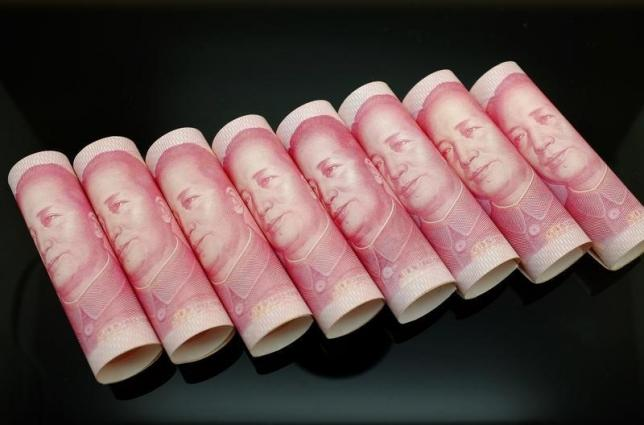 Wary of capital outflows, Japan urges China to go slow on yuan reform