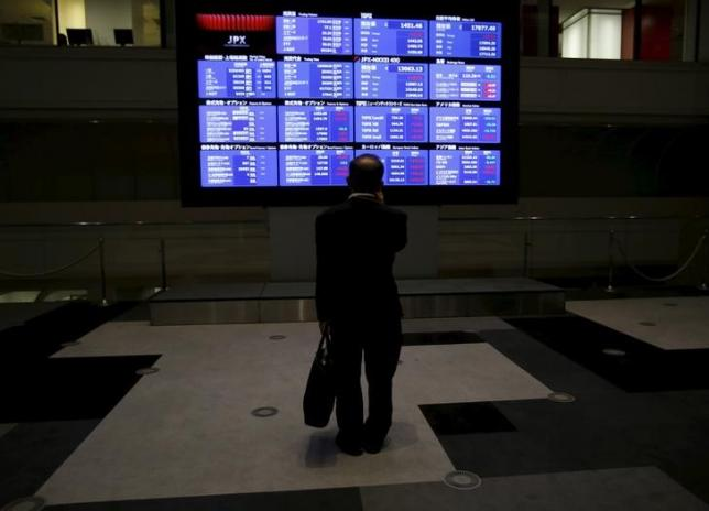 Euro and commodities skid, Asia stocks mixed