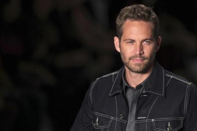 Lawyers for Porsche say actor Paul Walker to blame for his death