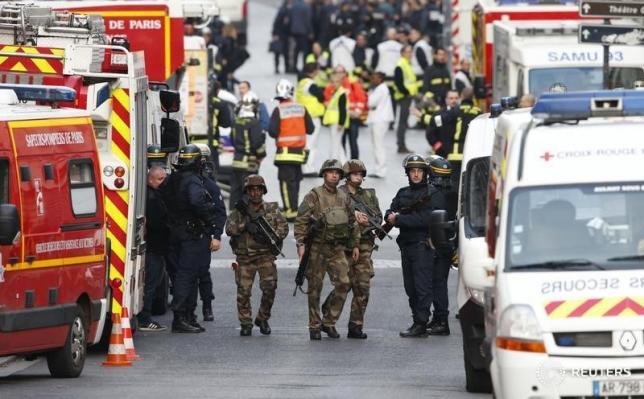 Two die in police raid targeting suspected Paris attack mastermind