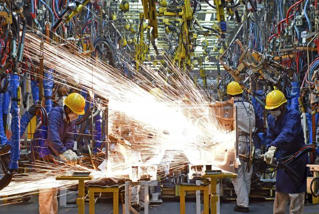 Asia's factories still struggling as US rate hike looms