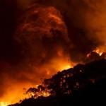 Australia evacuates three coastal regions as fire risk grows