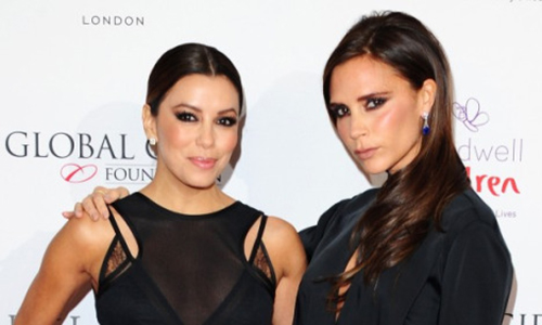 Friends Eva Longoria and Victoria Beckham attend gala