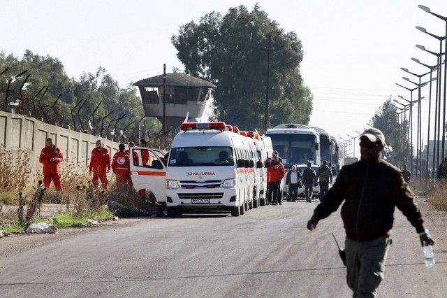 People leave rebel-held area in Syrian truce deal
