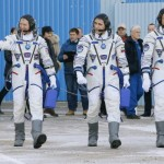Spaceship carrying three-man crew docks with space station, NASA TV reports