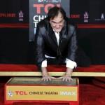 Tarantino shuns rain to leave imprint on Hollywood