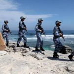 Philippine officials say China blocked access to disputed South China Sea atoll