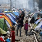 Greece steps up efforts to move migrants to sheltered camps