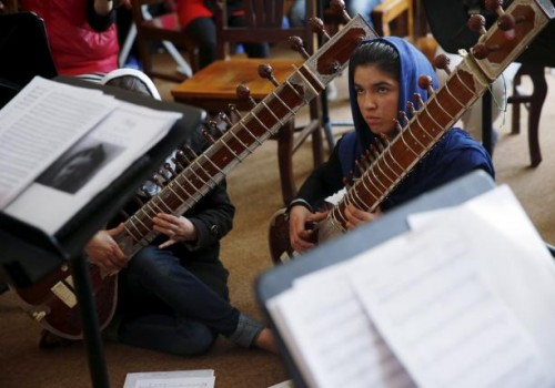 Members of the Zohra orchestra, an ensemble of 35 women, attend a rehearsal at Afghanistan's National Institute of Music, in Kabul, Afghanistan April 4, 2016.  REUTERS/Ahmad Masood