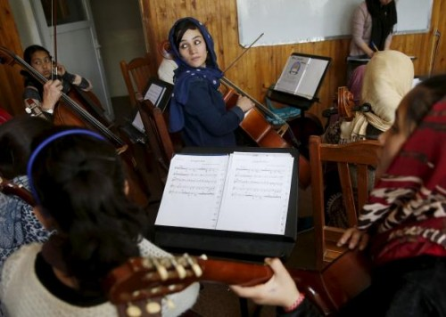 Fakria Azizi, a member of the Zohra orchestra, an ensemble of 35 women, practises during a session, at Afghanistan's National Institute of Music, in Kabul, Afghanistan April 4, 2016.  REUTERS/Ahmad Masood