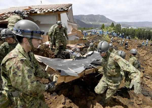 Japan rescuers search quake rubble for survivors as manufacturers count cost