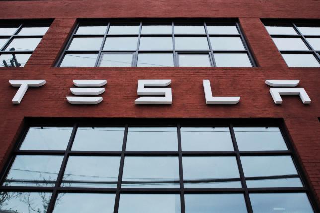 Tesla raises $1.46 billion in stock sale