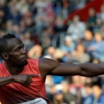 Bolt staves off false starts to move into 100m semi-finals