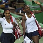 Tennis: Williams sisters crash out of doubles