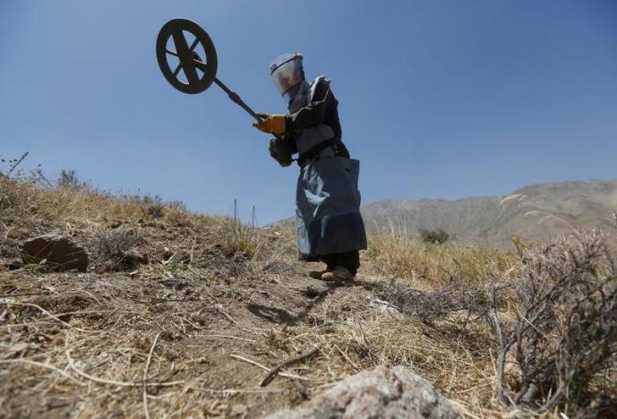 Funding cuts, insurgency hamper Afghan goal to clear mines by 2023