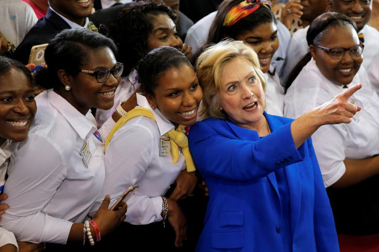 Clinton, as polls tighten, shifts focus to herself instead of Trump
