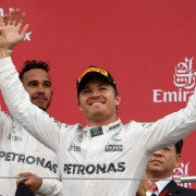 Formula One - Japanese Grand Prix - Suzuka Circuit, Japan- 9/10/16. Mercedes' drivers Nico Rosberg of Germany and Lewis Hamilton of Britain attend an awarding ceremony after the race. REUTERS/Toru Hanai
