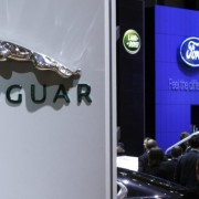 FILE PHOTOGRAPH - Logos of the carmakers Jaguar, Land Rover and Ford are pictured during the first media day of the 78th Geneva Car Show at the Palexpo in Geneva March 4, 2008.    REUTERS/Denis Balibouse