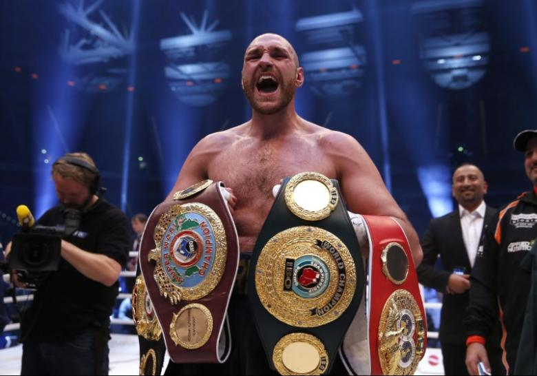 Fury vacates world heavyweight titles to focus on recovery