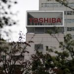 Toshiba shares slip as it gears up for chip unit sale