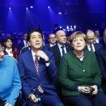 Germany's Merkel and Japan's Abe urge free trade with jabs at US
