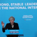 UK PM May pledges new powers to punish and tax social media firms