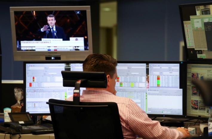 Global stocks, euro dip as Macron win shifts focus to economy