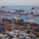 Japan's first quarter growth halved by oil inventory squeeze, recovery seen on track
