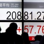 Asia stocks edge higher after Fed meeting; dollar, US yields sag