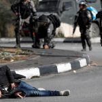 Israeli troops kill four Palestinians, wound 160 in protests over Jerusalem