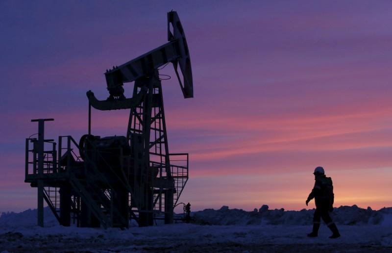 Oil inches down but Brent ends week firmer on Iran concerns