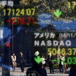 Asia stocks reach record highs after Wall St. surge, dollar edges back