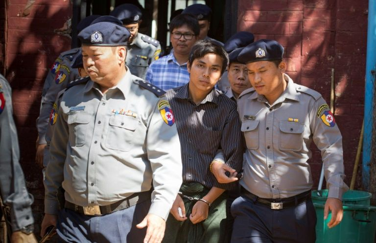 Reuters says Myanmar held journalists for probing Rohingya massacre