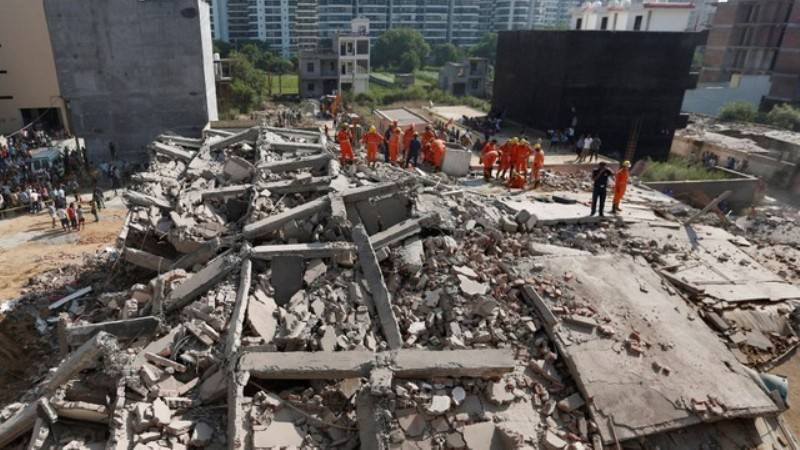 Buildings collapse in Delhi killing at least three, more feared dead