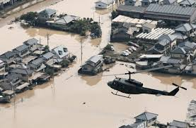 Rescuers race to find survivors after Japan floods kill at least 112