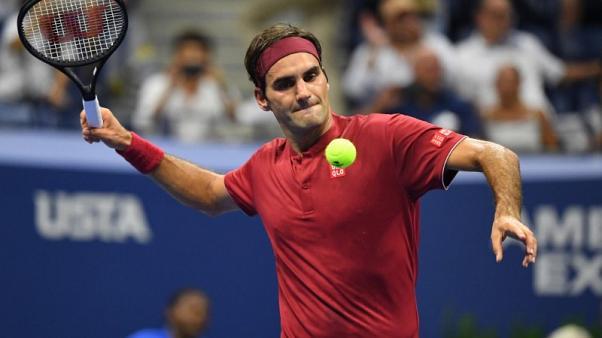 Federer makes short work of Nishioka in clammy New York