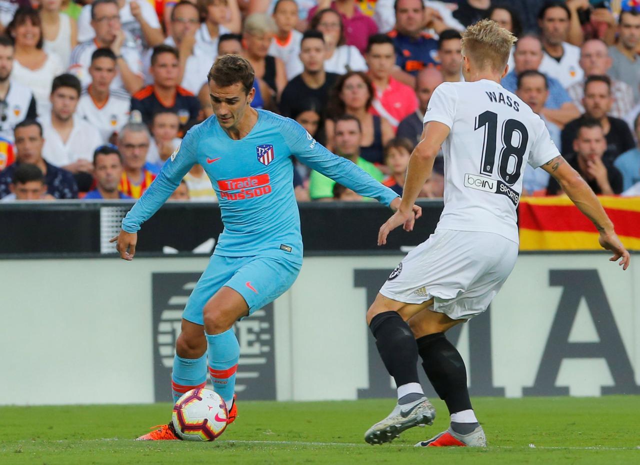 Barca, Atletico scrape past La Liga new boys