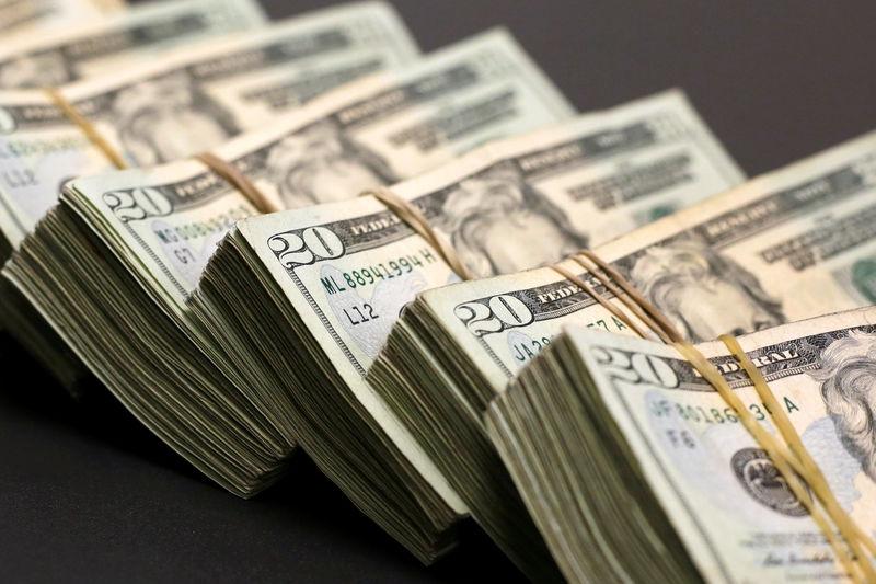Dollar slips, yen strengthens on Trump's Fed criticism