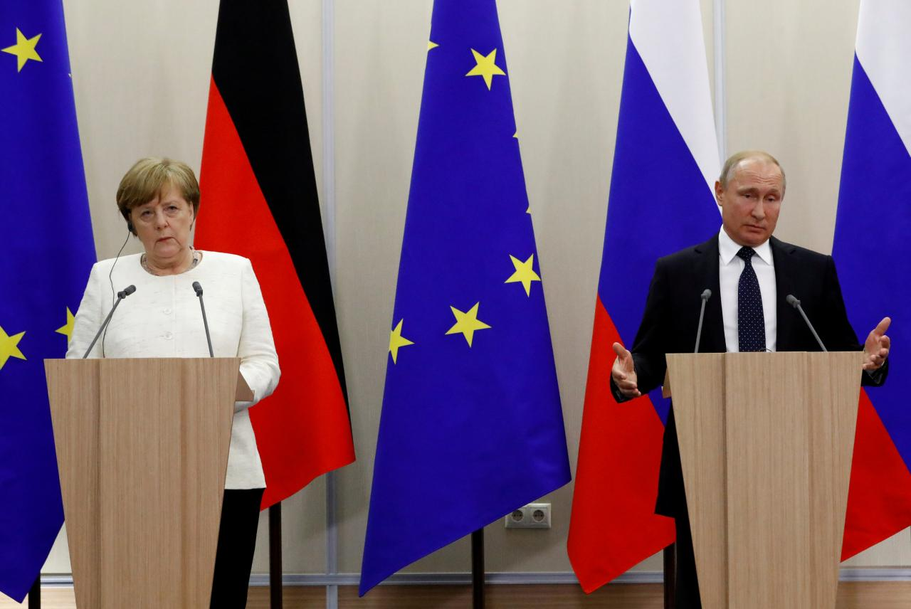 First a wedding, then hard work: Putin to visit Germany's Merkel