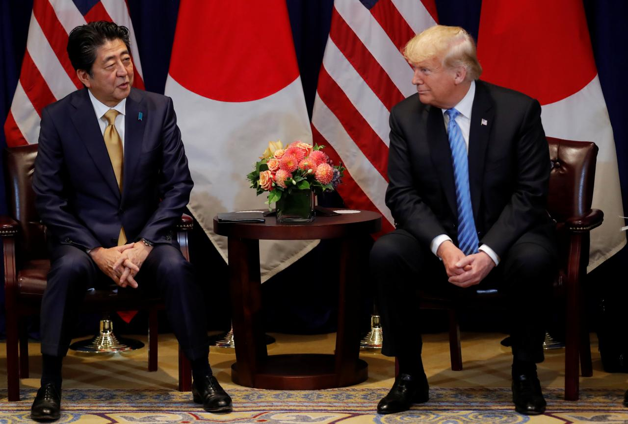 Japan dodges US auto tariffs, for now, as Trump and Abe agree on trade talks
