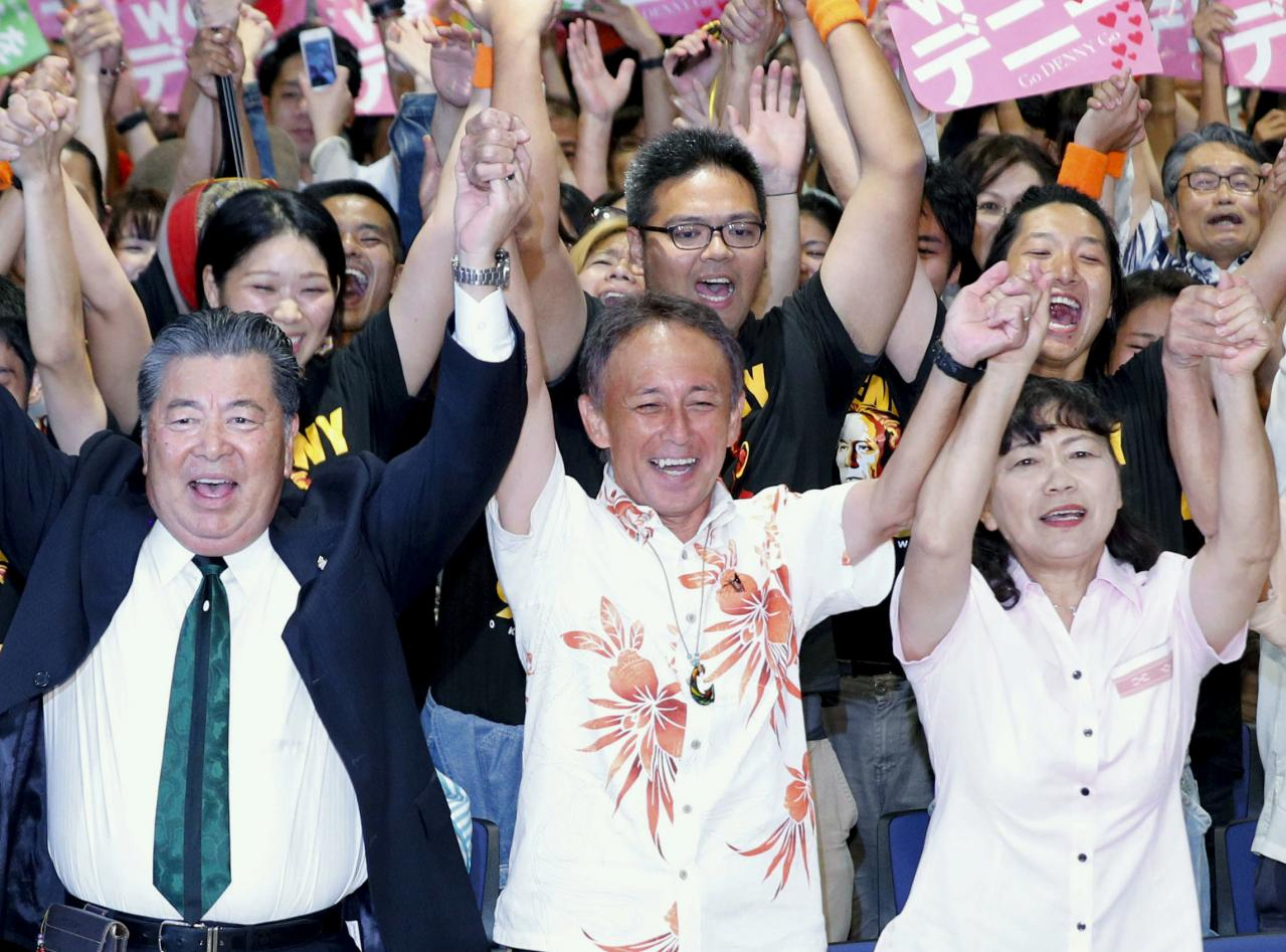 In blow to Japan PM, son of US Marine wins Okinawa governor vote